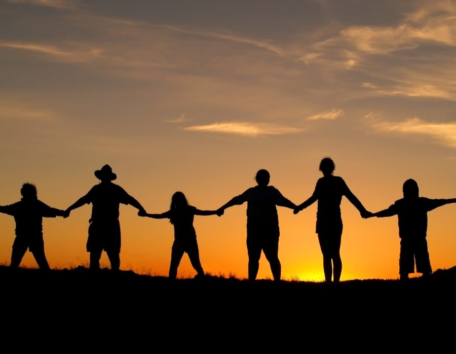 Many+people+join+hands+to+represent+a+family+unity.